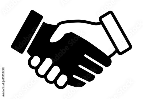 Black and white handshake or shaking hands in unity and