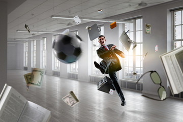 Playing football in office. Mixed media