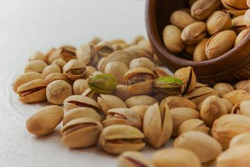 Pistachios on a kitchen table closeup