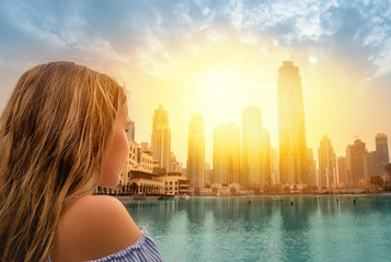 girl looking at a city skyline sunset