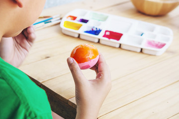 People painting colourful Easter eggs - people celebration national holiday concept