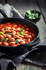 Tasty baked beans made of fresh tomatoes and herbs