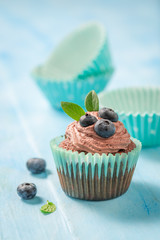 Delicious muffin made of chocolate cream and berries