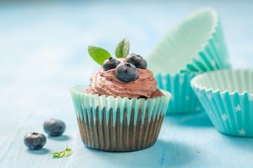 Homemade cupcake made of chocolate cream and berries