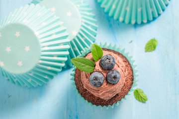Closeup of muffin with blueberries and chocolate cream