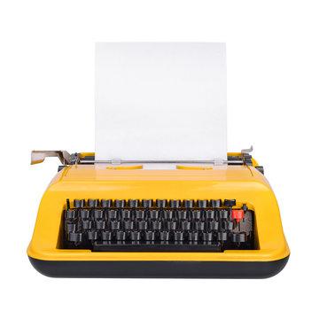Yellow typewriter isolated on white