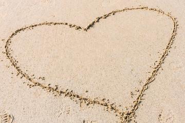 Heart shape drawn on sandy beach. Concept of love, romantic relationship