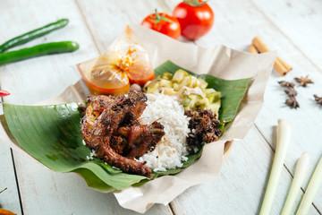 Nasi lemak kukus with quail