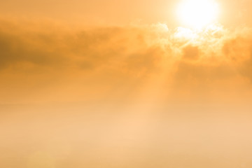 Sun rays behind clouds, weather background