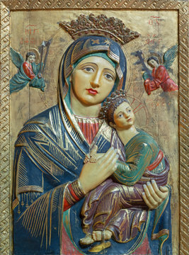 PALMA DE MALLORCA, SPAIN - JANUARY 26, 2019: The carved polychrome relief of Madonna (Our Lady of Perpetual Help) in church Iglesia de Santa Margarita by unknown artist.