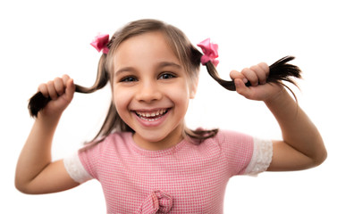 Close Up Portrait Of A Sweet Child Girl Holding Her Hair With Shallow Depth Of Field, Isolated On White Background