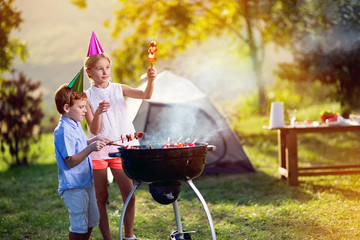 boy and girl having a barbecue party.