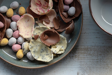 Cracked chocolate easter eggs in a ceramic bowl
