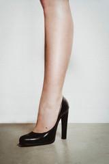 Leg and black heel isolated