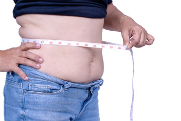 Close up of Woman measuring her waistline fat tummy isolate on white background with clipping path,obese women,Body part of a fat woman belly fat with measuring tape. She tried to control food or diet