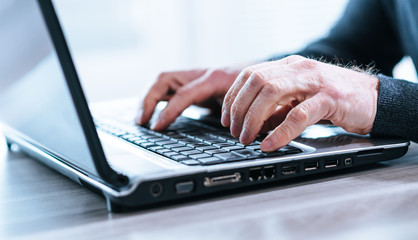 Male hands using a laptop