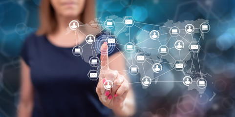 Woman touching a global network technology concept