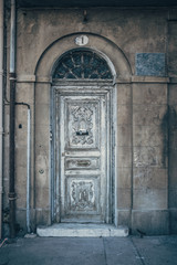 Architectural old wooden door in the street