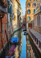 Parked boats. Beautiful Canal in Venice Italy