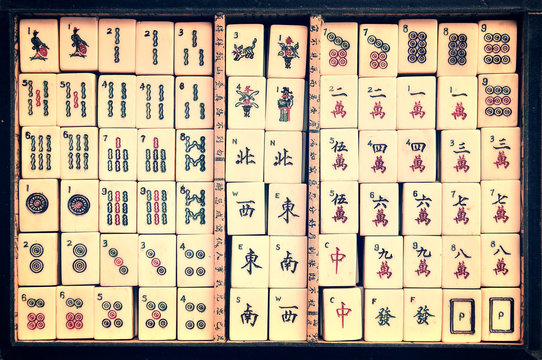 Top view of a box of antique Mahjong tiles