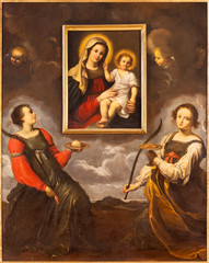 PARMA, ITALY - APRIL 17, 2018: The saints Lucy and Agata adoring the image of Madonna in church Chiesa di Santa Lucia by master of Parma school from first half of 17. cent.