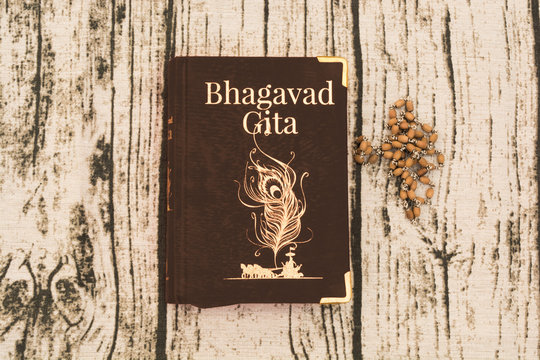 Maski,Karnataka,India - DECEMBER 29,2018 : Holy Bhagavad gita with wooden textured bckground.
