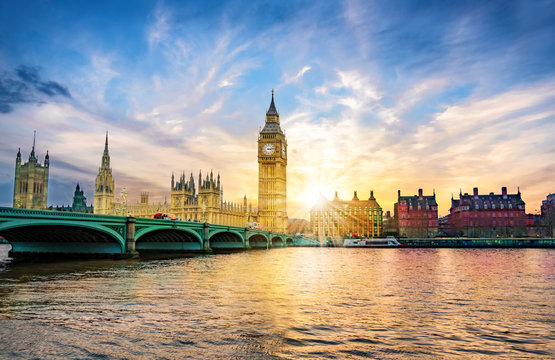 London cityscape with Big Ben and City of Westminster Abbey bridge in sunset light, in United Kingdom of England