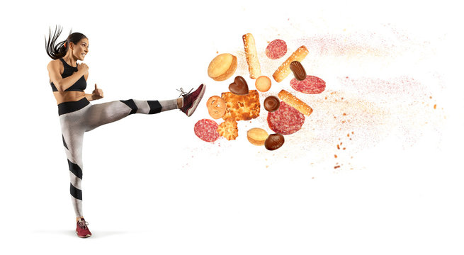 Fit young woman fighting off bad food i