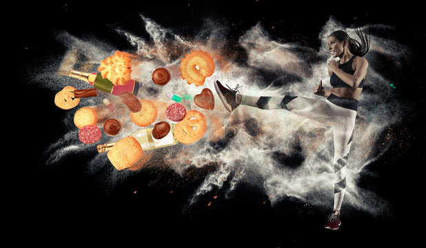 Fit young woman fighting off bad food