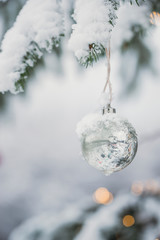 Christmas bauble decoration inside snow outside