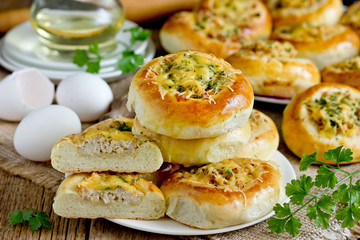 Homemade dinner buns stuffed with minced meat and cheese. Round meat patties from yeast dough for snack. Cheese meat pizza pies