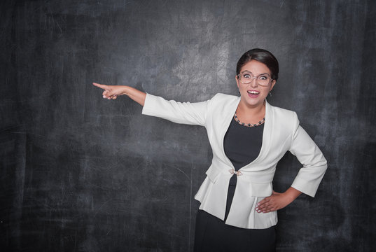 Angry screaming teacher pointing out on blackboard