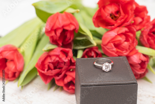 bouquet of tulips and engagement ring