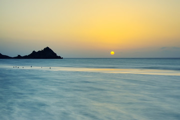 Fotobehang - Sunset on a wild beach on the Indian Ocean on the paradise island beach.long exposure.