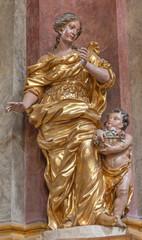 PRAGUE, CZECH REPUBLIC - OCTOBER 18, 2018: The carved polychrme statue of St. Elizabeth of Hungary in church Kostel Svaté Alexandrijské by František Ignác Weiss (1737 - 1741).