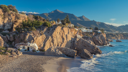 Nerja, Malaga, Andalusi, Spain - January 27, 2019: Start a new day at the small beach in the town of Nerja, southern Spain