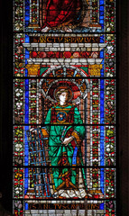 Tuinposter Imagination Saint Lawrence of Rome, stained glass window in Santa Maria Novella Principal Dominican church in Florence, Italy