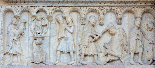 Wall Mural - MODENA, ITALY - APRIL 14, 2018: The romanesque relief of Kain and Abel from paradise on the facade of Duomo di Modena.