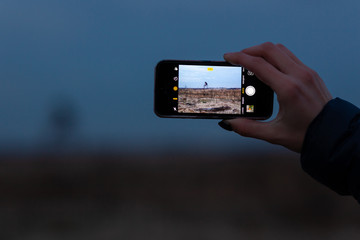 taking photo by mobile, hand holding mobile phone