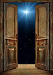 Old vintage opened doors with dark stars sky