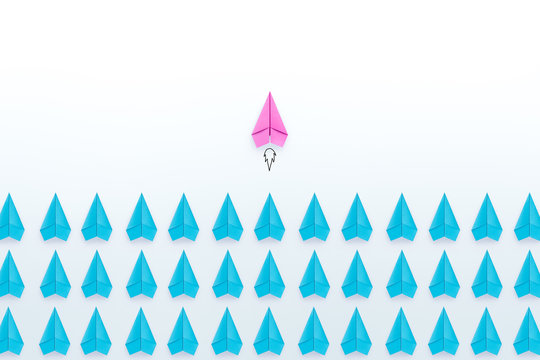 Women leadership concept with pink paper plane standing out from the group of blue paper planes on white background. copy space