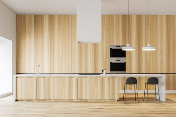 Minimalistic wooden kitchen with bar and ovens