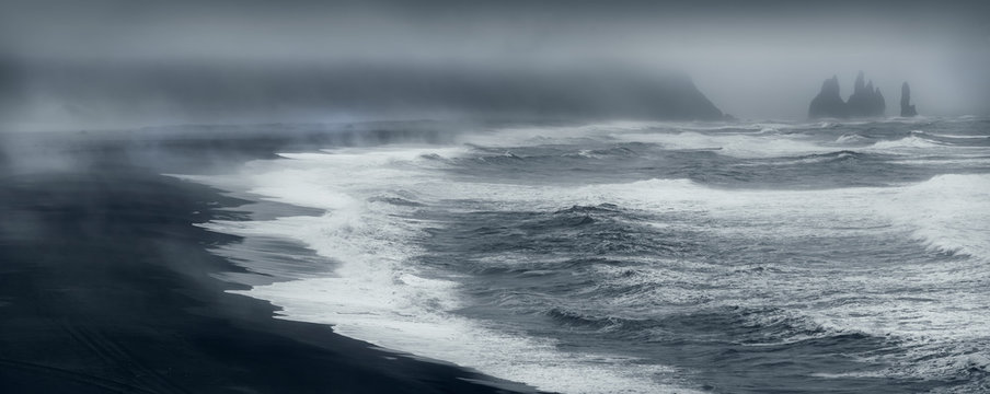 Famous Reynisfjara black beach on the south coast of Iceland from Durholaey cliff