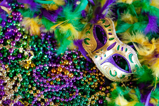 Mardi gras mask, beads and feathers background