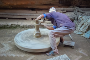 Potter in Bhaktapur demonstrating how to make pottery, a real craftsman, Nepal