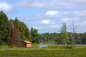 Forest Boathouse on the Lake