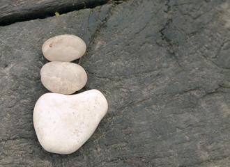 Zen pebbles on wooden bridge