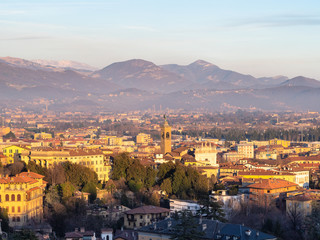 view of Bergamasque Alps and Bergamo at sunset