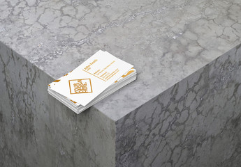 Stack of Business Cards on Concrete Surface Mockup