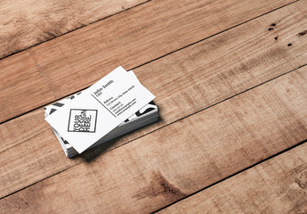 Stack of Business Cards on Wooden Surface Mockup